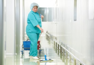 Woman cleaning hospital hall